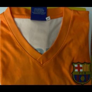 Boy's Orange Jersey Messi FCB size 10